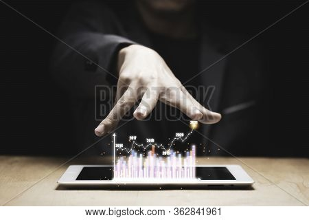 Businessman Hand Protect Virtual Infographic Graph With Tablet On Wooden Table. Is Is Value Investor