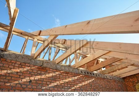 Roofing Construction On The Stage Of Roof Framing, Installation Of Wooden Trusses, Eaves, Braces And
