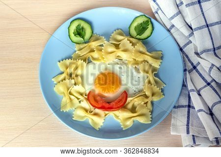 Child Food. Funny Food. Plate With Pasta With Fried Egg And Vegetables In The Form Of Funny Face. Ch