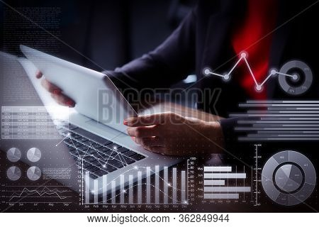 Businesswoman Working With Laptop And Virtual Statistic Graphics. Close-up Of Hands Of Woman Sitting