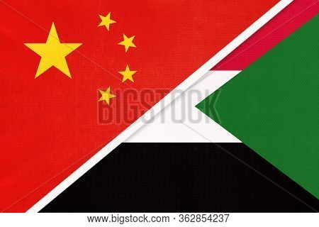China Or Prc Vs Sudan National Flag From Textile. Relationship Between Asian And African Countries.