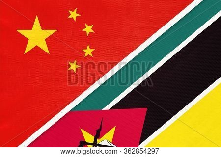 China Or Prc Vs Mozambique National Flag From Textile. Relationship Between Asian And African Countr