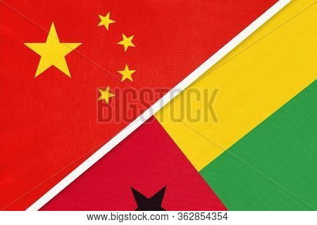 China Or Prc Vs Guinea-bissau National Flag From Textile. Relationship Between Asian And African Cou
