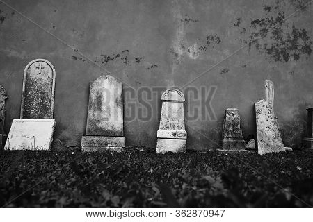 Abandoned Cemetery Old Cement Gravestones Laying Around.