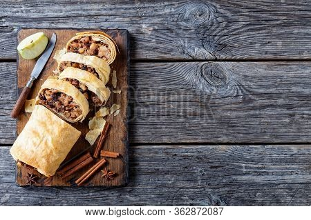 Crispy Baked Austrian Dessert: Apple Strudel Of Phyllo Dough With Caramelized Apples, Nuts, Cinnamon