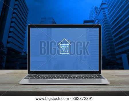 Work From Home Flat Icon With Modern Laptop Computer On Wooden Table Over Office City Tower And Skys