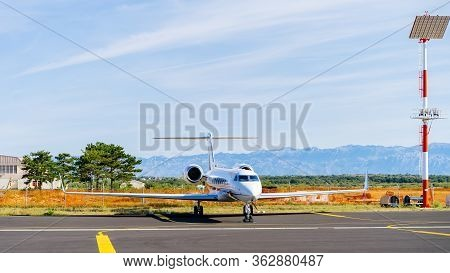 Small White Private Jet Parked In Airport. Wealthy People Turn To Private Jets To Avoid Coronavirus