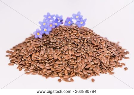 Flax Seeds On A White Background. Flax Seeds Useful For Health. Close-up.