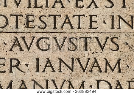 Latin Ancient Language. Inscription From The Famous Res Gestae (1st Century Ad), With The Word Augus