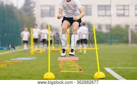 Footballers On Practice Session In Field On Sunny Day. Soccer Player On Fitness Training. Young Socc
