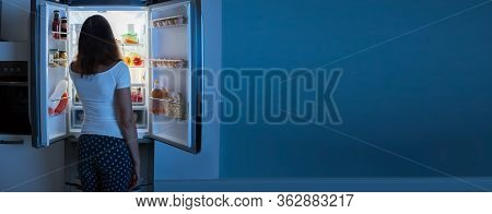 Hungry Person Eating Food From Fridge At Night