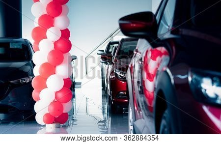 New And Shiny Luxury Suv Car Parked In Modern Showroom With Sale Promotion Events. Car Dealership Of