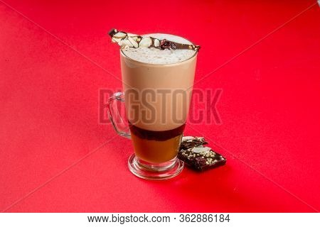 Mocha Coffee In A Transparent, Glass Cup On A Red Background