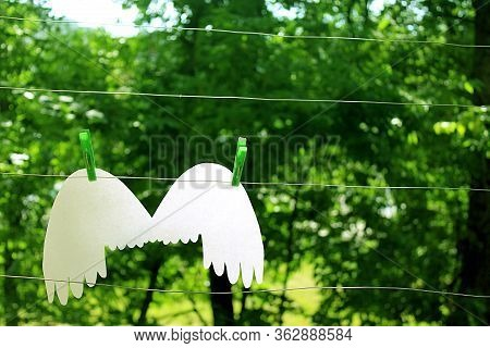 White Angel Wings On A Clothesline Horizontal Left