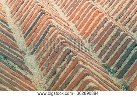 Rustic Bricks Of Reddish Colors In Rows Of Pyramidal Shape.