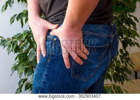 The Manifestation Of Pain In The Hip Joint Concept Photo. The Man Grabbed His Upper Thigh Where The