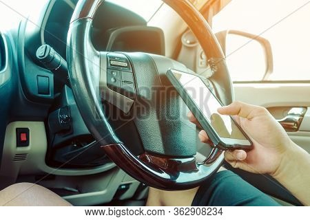 Young Man Use The Telephone To Send Text Messages To Girlfriends While Driving .dangerous Driving Wh