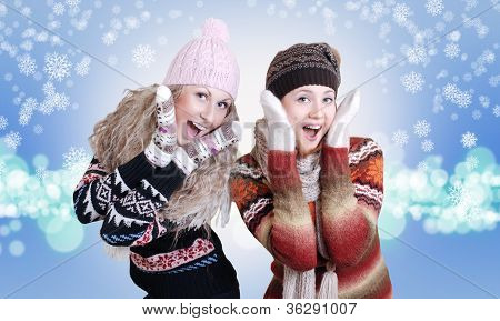 Two Pretty Laughing Surprised Girls In Winter Clothes