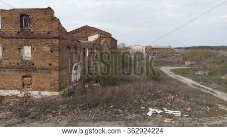 Old abandoned sugar factory in Viinitsia region, aerial view. Broken old factory. Destroyed house