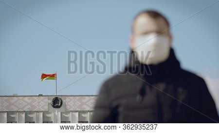 Focus On Flag And Coat Of Arms Of Belarus On Administrative Government Building. Man Citizen Wears M