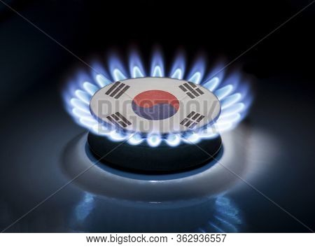 Burning Gas Burner Of A Home Stove In The Middle Of Which Is The Flag Of The Country Of South Korea.
