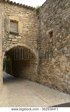 Stone Passageway In The Medieval Village Of Peratallada, Located In The Middle Of The Emporda Region