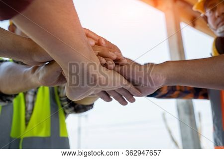 Engineers Join Hands To Build Successful Projects,team Job Of Teamwork Engineer Work Together In A C