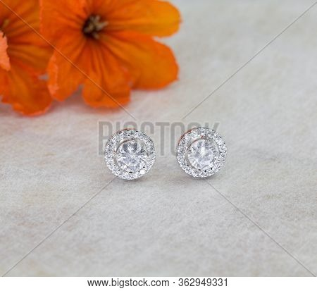 A Pair Of Beautiful 925 Sterling Silver Earrings With Cubic Zirconia Isolated On Gray Background