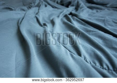 Top View Of Blue Blanket That Wrinkles On The Bed After Sleep In A Long Night.