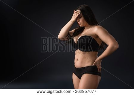Plus Size Girl In Underwear With Facepalm Gesture On Black Background