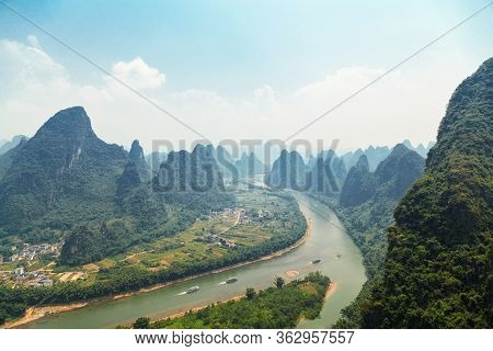 Guilin Mountain Viewview Of Guilin Mountains On A Clear Sunny Day And The Li River Floodplain Below