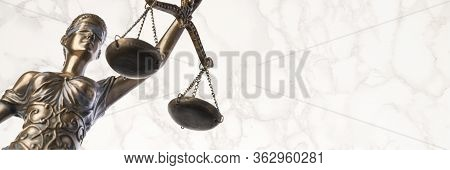 Bronze Themis Statue - Symbol Of Justice - Viewed From A Low Angle With A Marble Background