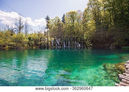 Beautiful Breathtaking Green Water Of Plitvicka Lake In Croatian National Park.