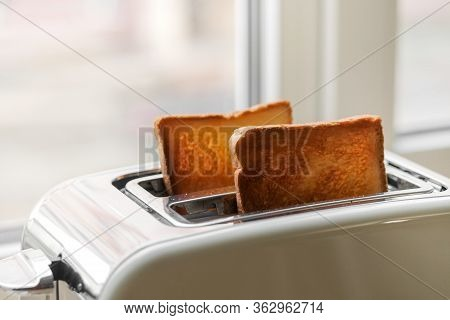 Freshly Baked Toaster Bread. A Couple Of Crusty Toasts In The Toaster, Close-up. Delicious Breakfast