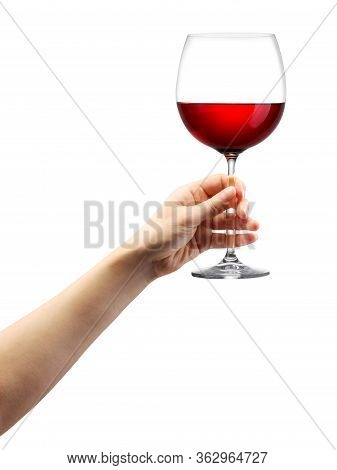 Woman Hand Holding Red Wine Glass Isolated On White.