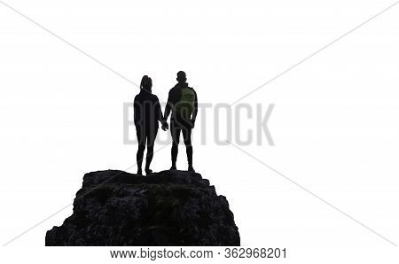 Adventurous Couple Holding Hands And Standing On Top Of A Steep Rocky Cliff. White Background Isolat