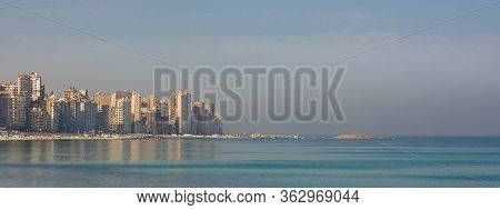 Mediterranean Coast At Miami District, Alexandria City, Egypy, With Very Tall Buildings By The Seasi
