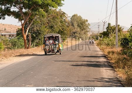 Indian Women Travel In Rickshaw Taxi Along The Road Of Puttaparthi Village, India