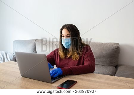 Girl Telecommuting With Mask And Gloves From Home By Confinement