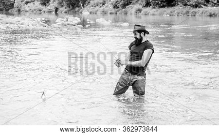 Fisher With Fishing Equipment. Fisher Weekend Activity. Fish On Hook. Leisure In Wild Nature. Fishin