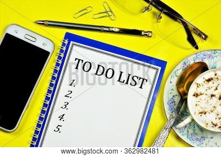 To-do List Is Written On A Notepad. Action Plan For The Future. Rationally Constructed Mode Of Life