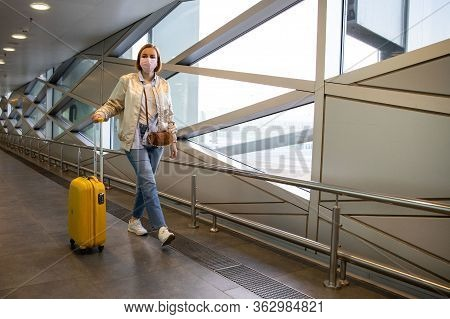 Passenger Woman Wearing A Medical Protective Mask For Prevent Coronavirus Walking With Her Luggage W