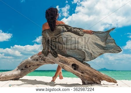 Young woman on the tropical white sand beach