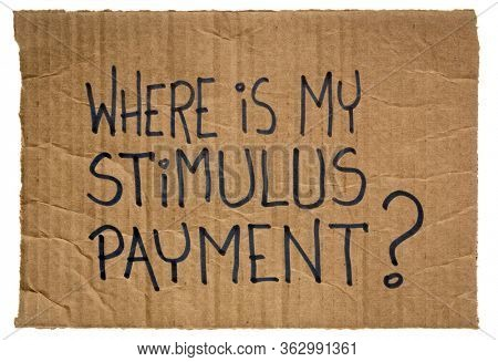 Where is my stimulus payment? Handwriting on a piece of cardboard. Economic recession and relief bill during coronavirus covid-19 pandemic.