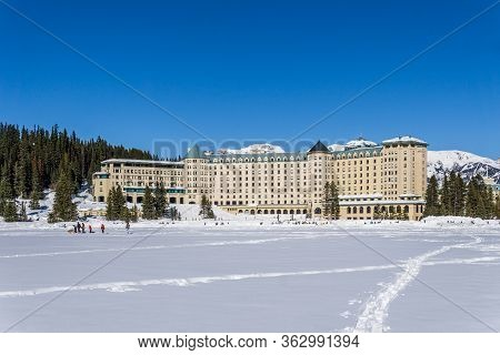 Lake Louise, Canada - March 20, 2020: Fairmont Chateau And Frozen Lake Louise Spring Time.