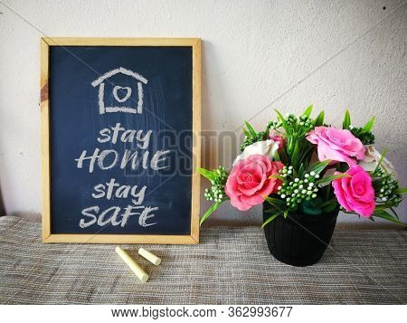Stay home stay safe, written on blackboard