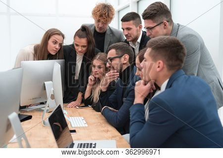 exultant business team looking at the screen of the office computer