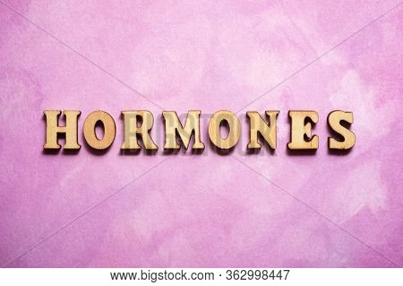 Hormones text on a colored paper.