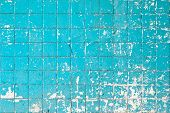 Grunge texture of blue broken tiles on old wall poster