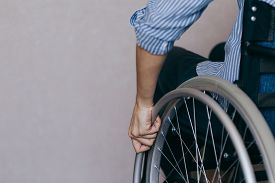 Disabled Young Girl. Woman At Home On A Wheelchair. Recovery And Healthcare Concepts.